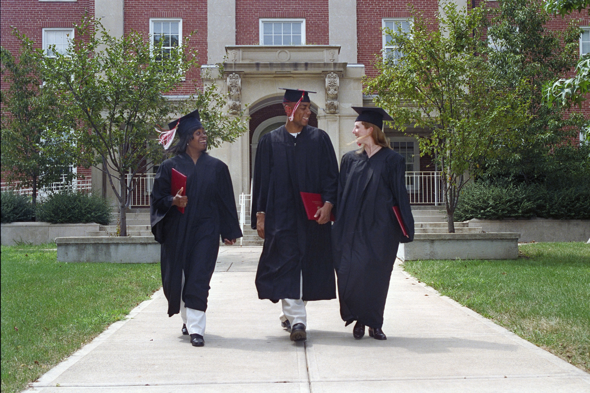 Graduates Walking Across Campus